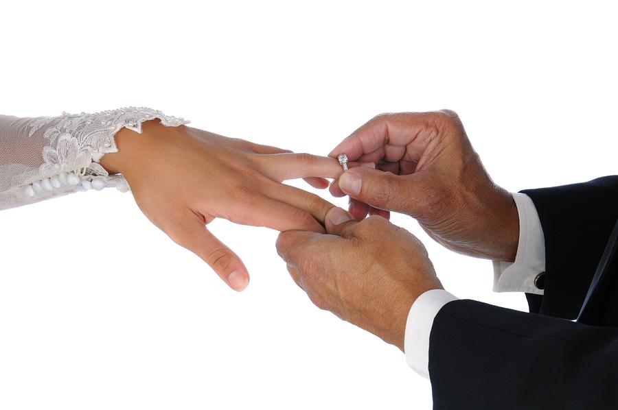 bigstock-Closeup-of-the-groom-placing-a-39640351